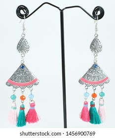 colorful designer earrings in white copy space background. Indian jewelry and product photography