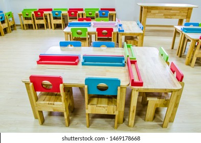 Colorful desk and chair set in the kindergarten classroom.