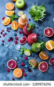 Colorful detox smoothie in bottles, summer diet fresh drink, red, green, yellow smoothie with berries and fruits