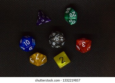 Colorful dice on black background, flatlay