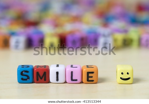 Colorful dice with SMILE word