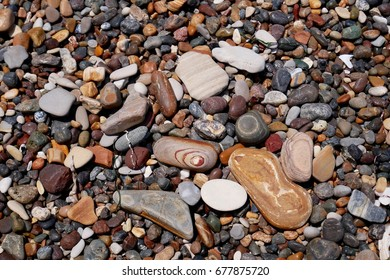 Colorful and different shape of pebbles on the California beach USA.