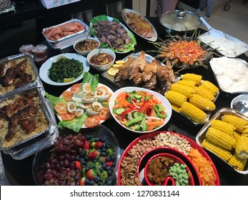 Colorful dinner with fruits, vegetables, meat, chicken, rice and desserts