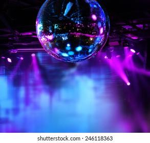 Colorful disco mirror ball lights night club background