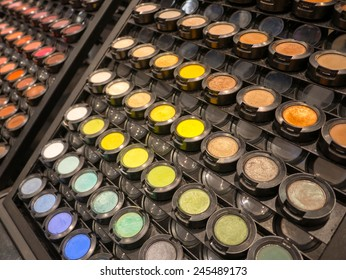 Colorful display of eye makeup in an open shop with eye shadow in all the colors of the spectrum