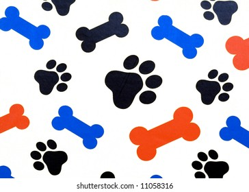 Colorful dog bone snacks and paw prints over a white background