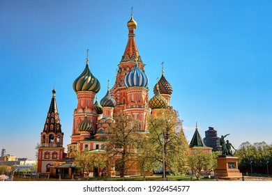 Colorful domes of the St. Basil's Cathedral on a spring sunny day with blue sky. Red square in Moscow, capital of Russia. Tourist places of Moscow in summer travel to Russia.