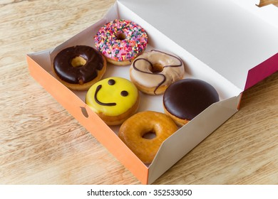 Colorful donuts in box