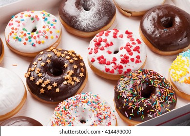 Colorful donuts box on stone table