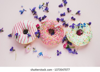 colorful donuts on pink background. Party food concept
