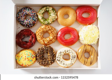 colorful donuts in a row, in paper box , top view