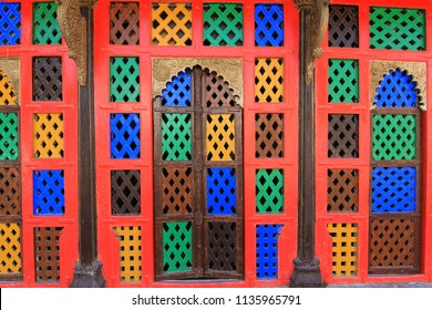 Colorful doors with local jali design at the Narayan Sarovar Temple in Kutch region in Gujarat in India.