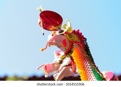 Colorful dragon toys on blue sky background for children in China new year festival.