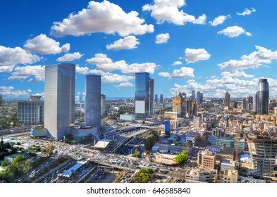 Colorful dramatic HDR image of the cloudy skyline of Tel Aviv with its skyscrapers - aerial image, Israel