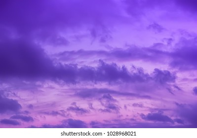 Colorful dramatic lilac sky and ultra violet clouds - nature background with space for copy.