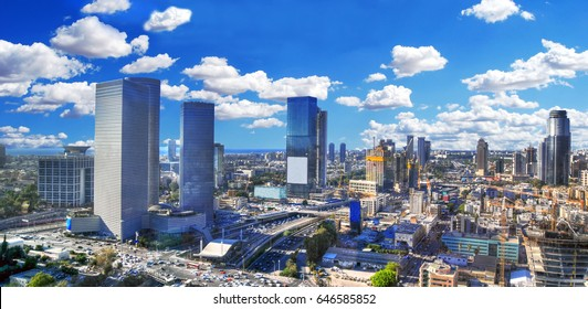 Colorful dramatic and panoramic HDR image of the cloudy skyline of Tel Aviv with its skyscrapers - aerial image, Israel