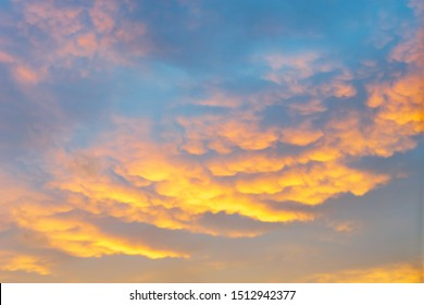 Colorful dramatic sky with clouds at sunset or sunrise.