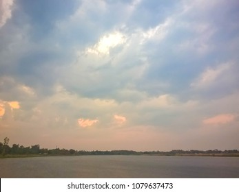 Colorful dramatic twilight sky in evening with cloud at sunset over Lake in Udonthani Thailand .Nice Clear Nature Blue Sky with sun background.