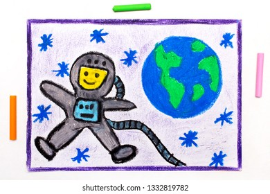 Colorful drawing: Happy astronaut in spacesuit flying next to the planet earth