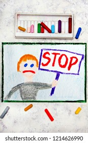 Colorful drawing: Sad boy holding a STOP sign in his hand