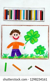 Colorful drawing: A smiling man holding a four-leaf clover. Saint Patrick's Day