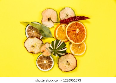 Colorful dried fruits isolated on yellow background