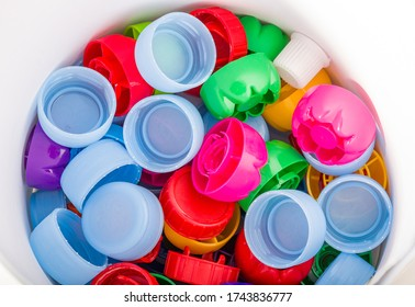 Colorful drink caps. Segregation of rubbish. Recycling - collecting plastic.
