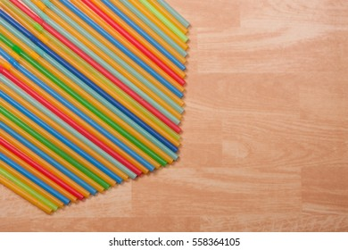 Colorful drinking straws on a beige background