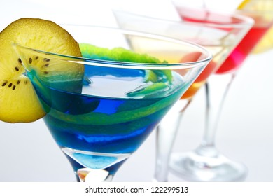 Colorful drinks in cocktail glasses closeup