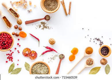 Colorful dry herbs and spices for cooking food white kitchen table background top view space for text