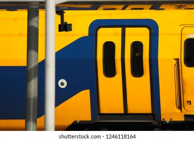 Colorful dutch yellow and blue railway wagon (Nederlandse spoorwegen), Utrecht, Netherlands