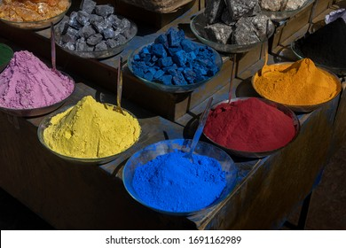 Colorful dye pigments and minerals in the medina of Marrakech, Morocco. Pigments for dyeing fabrics, silk, cotton, and yarn, etc.