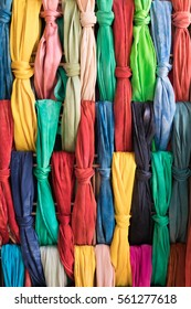Colorful Dyed Cloth Tied in Knots on a Rack