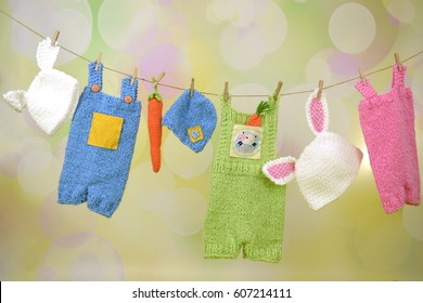 Colorful Easter baby clothes on a clothesline
