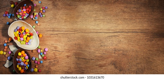 Colorful Easter candies on a rustic wood background