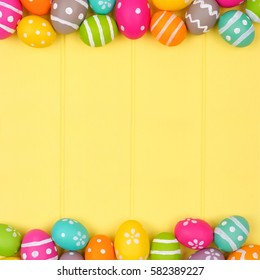 Colorful Easter egg double border against a yellow wood background