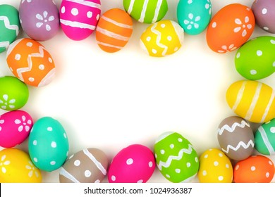 Colorful Easter egg frame isolated on a white background. Top view with copy space.