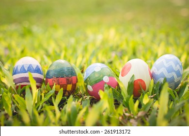 colorful Easter egg in the fresh spring meadow.