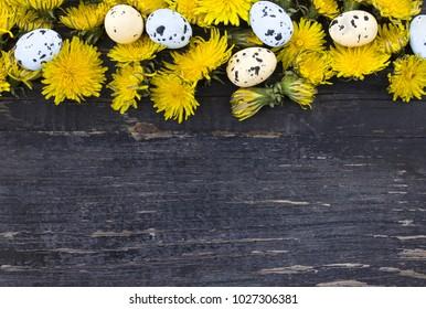 Colorful Easter egg side border against dark wood