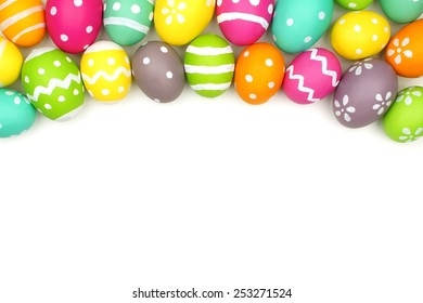 Colorful Easter egg top border against a white background