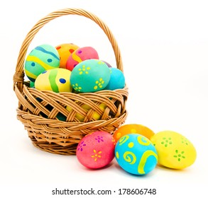 Colorful easter eggs in the basket isolated on a white background