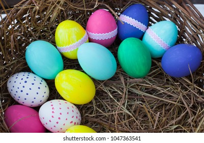 Colorful easter eggs in basket. Top view.