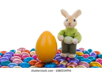 Colorful easter eggs and bunny over white background