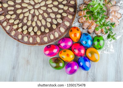 colorful  easter eggs and easter cake on wooden table