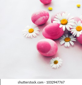 colorful easter eggs with daisy flowers