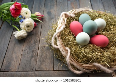 Colorful easter eggs decorated with a bunch of flowers on old wooden floor