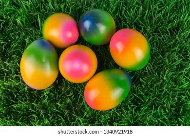 Colorful Easter eggs in grass, view from above