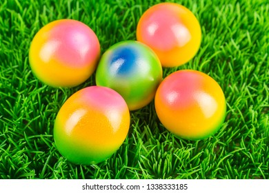 Colorful Easter eggs in the meadow