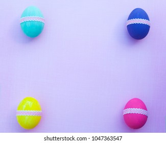 Colorful easter eggs on background. Top view with copy space