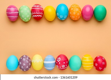 Colorful easter eggs on beige background